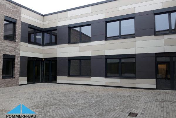 Schule Eternit Fassade